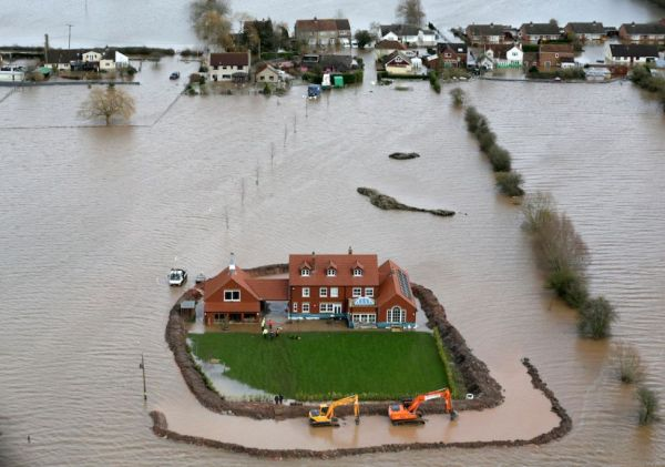 A dike-protected home in Somerset, England, surrounded by flood waters.